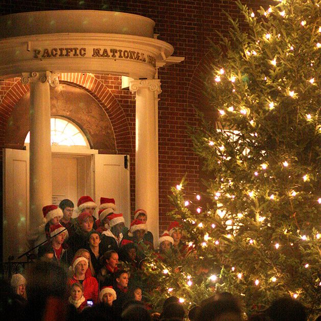 Tree Lighting Ceremony And High School Choir Lead The Community In Christmas  Caroling. Takes Place At The Top On Main Street At The Pacific Bank Steps.